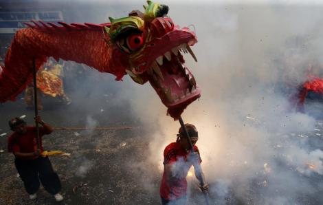 Revelers explode firecrackers as they celebrate Lunar New Year at Manila's Chinatown on Feb. 19, 2015. The Chinese Lunar New Year on February 19 will welcome the Year of the Sheep (also known as the Year of the Goat or Ram). (Erik DeCastro/Reuters) Thanks to The Boston Globe Free Share